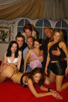 Eight swingers at the sex orgy